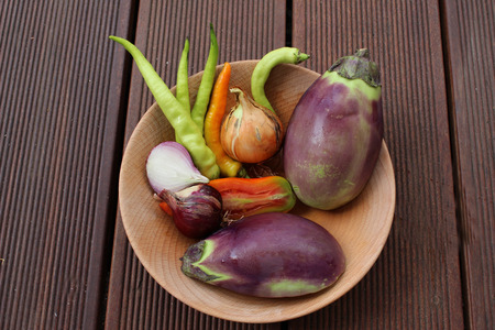 mixture: a Mixture of organic vegetables on a wooden plate