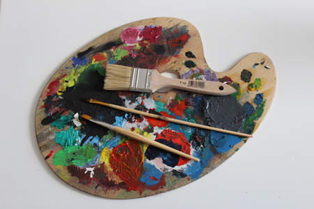 painter's palette: painters palette with colors and brushes Stock Photo