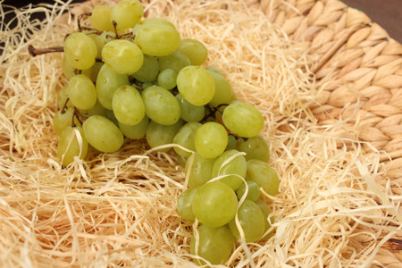 stored: juicy white grapes Stored in the straw Stock Photo