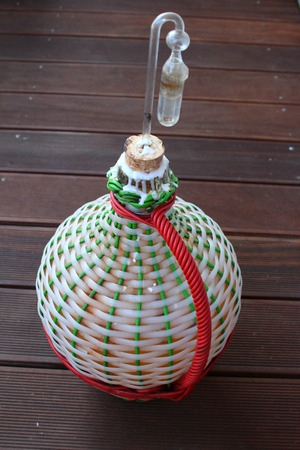 carboy: Braided carboy with homemade fruit wine