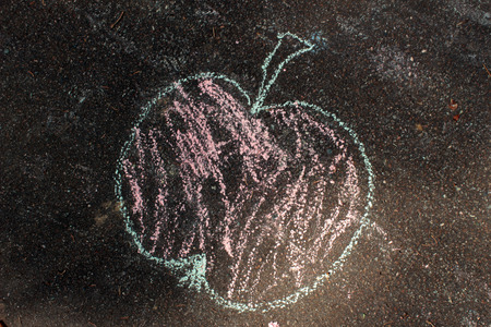 chalks: Kids drawing with colored chalk outside - street walkway floor