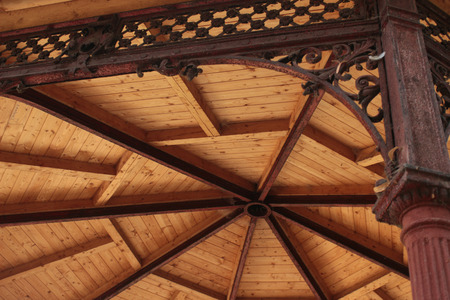 Interior view of a pitched timber roof showing the ridge, rafters and sheathing Stock Photo
