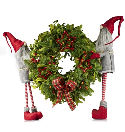 Christmas wreath carried by elves Stock Photo