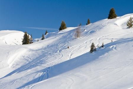 Winter landscape - ski tracks in powder snow, French Alps
