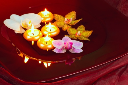 Floating candles and orchid - spa concept photo