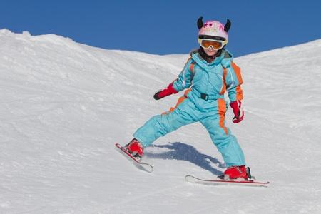 downhill skiing: Little girl skiing downhill Stock Photo