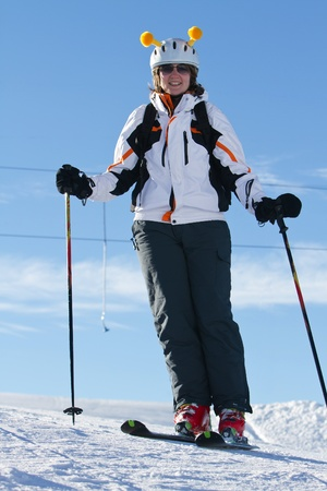 Female downhill skier with funny helmet photo