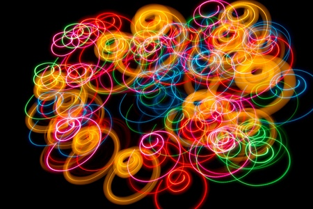Abstract lights painting (spirals) of colors on black background Stock Photo - 12470154