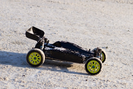 RC model 1 10 buggy car   electric powered   on snowy road photo