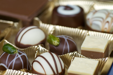 boxed: Box of various luxury chocolates, selective focus Stock Photo