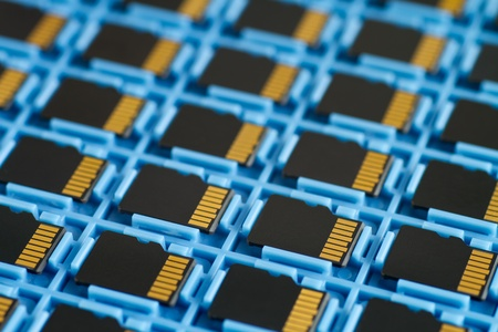 MicroSD memory cards for mobile phones on a transport tray, selective focus Stock Photo