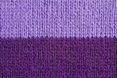 Lilac and violet color wool knitted background closeup photo
