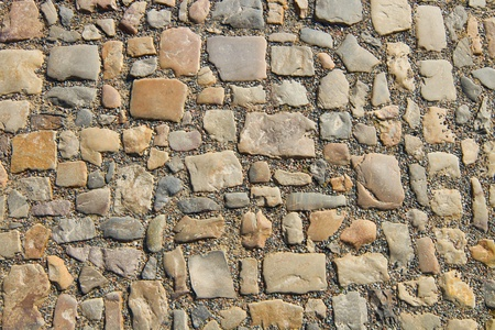rough road: Granite cobblestoned pavement background