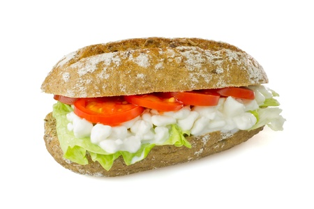 Vegetarian sandwich on white background - lettuce, cottage cheese, tomatoes on wholegrain bun, clipping path included