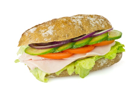 Healthy wholegrain sandwich - lettuce, ham, tomatoes, cucumber and red onion  Stock Photo