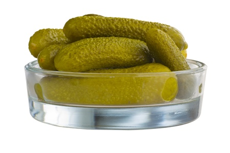 Sour picled gherkins in a glass bowl, isolated, clipping path included