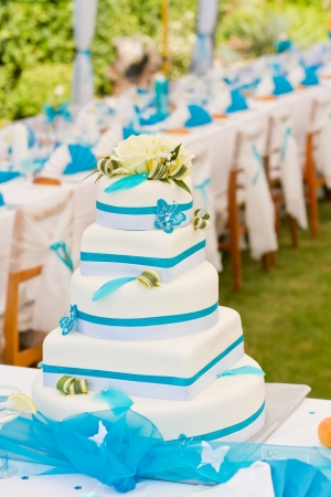 Wedding cake and luxury table setting in white and blue colors photo
