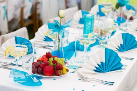 Luxury wedding lunch table setting outdoors, in white-blue colors photo