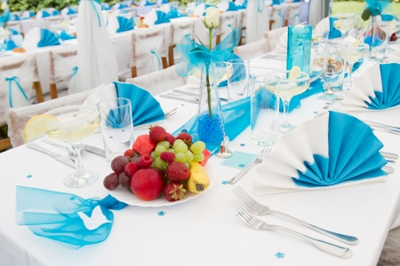 wedding table decor: Luxury wedding lunch table setting outdoors, in white and blue colors