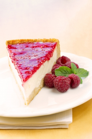 Slice of delicious delicious raspberry cheesecake on a plate ready to eat