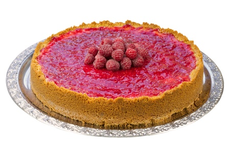 Whole homemade raspberry cheesecake on a serving dish, isolated, clipping path included Stock Photo