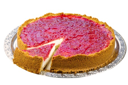 Wedge of homemade raspberry cheesecake cut out on a serving dish, isolated on white, clipping path