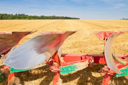 stubble field: Detail of agriculture plough and stubble field under blue sky