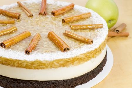 Whole apple cake - grated apple in gelatine, light vanilla cream on chocolate pastry