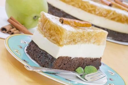 gelatine: A piece of an apple cake - grated apples in gelatine, light vanilla cream on chocolate pastry