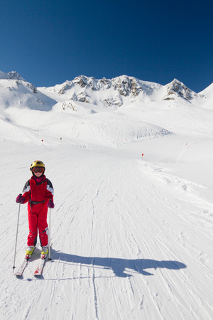 10 years girls: Happy girl skier enjoying skiing downhill in Stubai, Austria Stock Photo