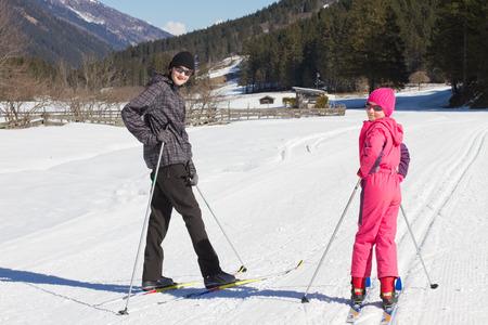 nordic ski: Teen boy and little girl cross country skiing in Alp Stock Photo