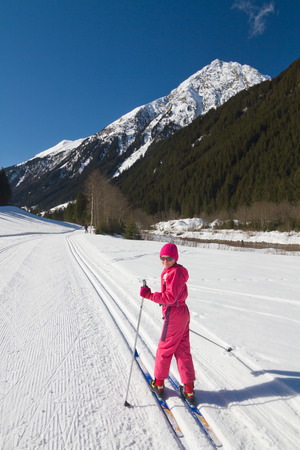 crosscountry: Portrait of cute little girl cross-country skiing