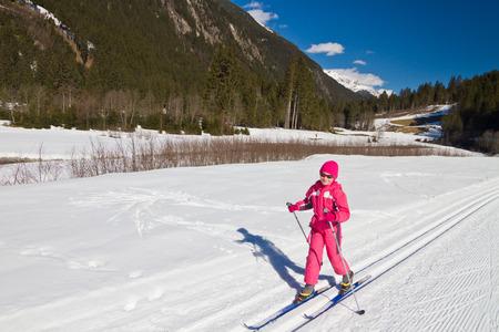nordic ski: Portrait of cute little girl cross-country skiing