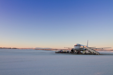 Plane waiting for passangers in Kittila airport, Finland - gate to Lapland