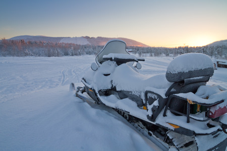snowmobile: Snowmobile parked in Lapland Stock Photo