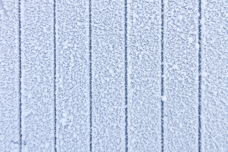 Frosty wooden wall - abstract winter background photo