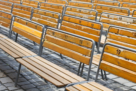 worn out: Worn out benches at open air auditorium in rows