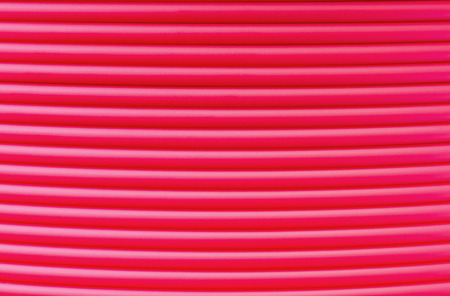 grooved: Abstract textured background - detail of ABS plastic filament winded on a spool - one of material for 3D printing Stock Photo