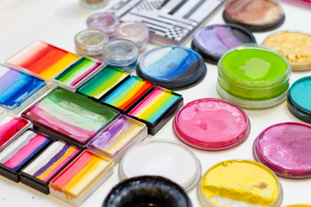 paint box: Selection of various vibrant and pastel color palettes  for face and body painting, selective focus Stock Photo