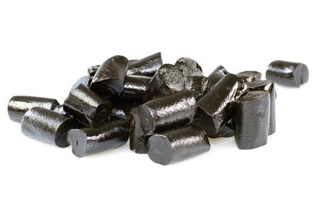 Black fresh liquorice candies isoated on white background