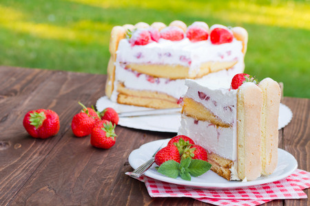 strawberry cake: Delicious strawberry cake Charlotte on a wooden background