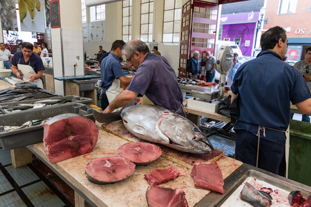 fish market: Funchal, Madeira island, Portugal - July 7, 2015: Fish sellers at Mercado dos Lavradores, the famous fish and seafood market in the capital of Madeira island.