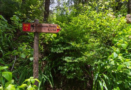 Touristic signpost for levada walk PR 9 Caldeirao Verde in Madeira island