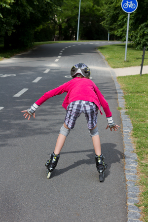 10 years girls: Girl roller skating and is close to a fall - dangerous and scary situation