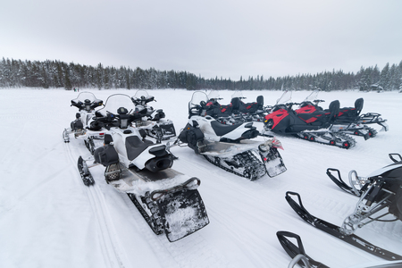 snowmobile: Group of snowmobiles ready to go Stock Photo