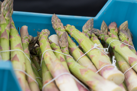 Transportation crate full of fresh and delicious green asparagus Stock Photo
