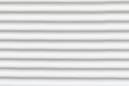 White and gray exterior wall background. Wavy horizontal pattern. Stock Photo
