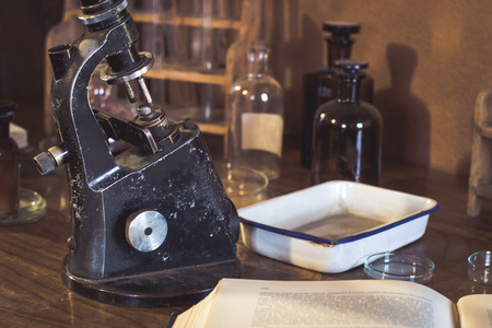 Antique laboratory  microscope and  glassware with selective focus. Science and medical research concept Reklamní fotografie
