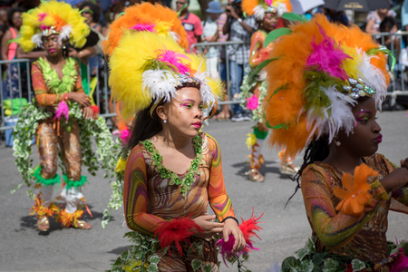 Pointe-a-Pitre, Guadeloupe, February 11, 2018: Portrait of a beatiful black girl in fancy dress participating at carnival parade in Guadeloupe, Caribbean Editorial