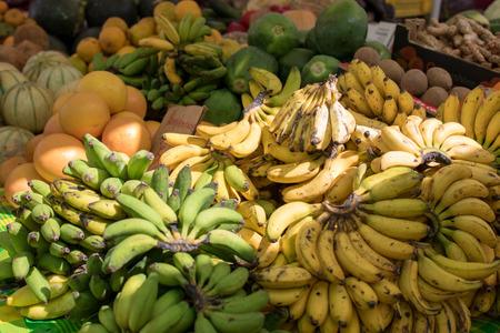 Bunches of small bananas on display in a local market in Guadeloupe, Caribbean